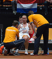 The Netherlands, Den Bosch, 20.04.2014. Fed Cup Netherlands-Japan, Kiki Bertens (NED) receiving medical treatment<br /> Photo:Tennisimages/Henk Koster