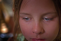 Young girl with blue eyes stares away from camera<br />