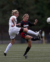 Boston College forward/midfielder Kate McCarthy (21) and NC State forward Meagan Proper (3) battle for the ball. Boston College defeated North Carolina State,1-0, on Newton Campus Field, on October 23, 2011.