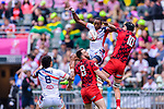 Perry Baker of USA (C) jumps for gets the ball against Cai Devine of Wales (R) during the HSBC Hong Kong Sevens 2018 match between USA and Wales on April 7, 2018 in Hong Kong, Hong Kong. Photo by Marcio Rodrigo Machado / Power Sport Images