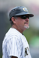 Charlotte Knights coach Tim Esmay (9) coaches third base during the game against the Gwinnett Braves at BB&T BallPark on May 22, 2016 in Charlotte, North Carolina.  The Knights defeated the Braves 9-8 in 11 innings.  (Brian Westerholt/Four Seam Images)