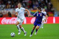 Abby Wambach (l) of team USA and Azusa Iwashimizu of team Japan during the FIFA Women's World Cup Final USA against Japan at the FIFA Stadium in Frankfurt, Germany on July 17th, 2011.