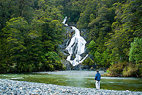 Fantail waterfalls and child - South Westland, West Coast, New Zealand