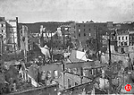 View looking over the tops of ruined South Main Street buildings and the burned-out area of Bank Street after Waterbury's 1902 fire.