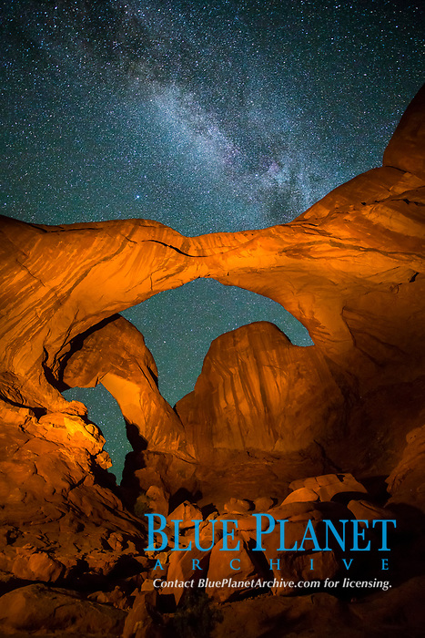 Double Arch and the Milky Way, stars at night, Arches National Park, Utah, USA