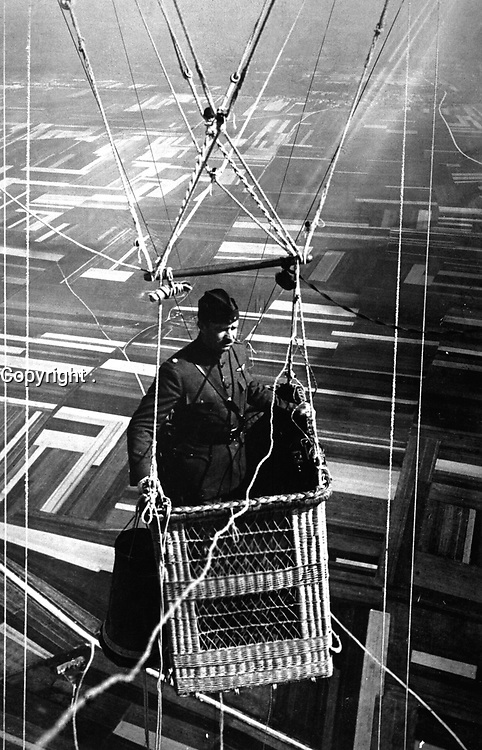 Close-up view of an American major in the basket of an observation balloon flying over territory near front lines.  June 1918.  (Army)<br /> Exact Date Shot Unknown<br /> NARA FILE #:  111-SC-18580<br /> WAR & CONFLICT BOOK #:  610