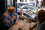 © Joel Goodman - 07973 332324 . 24/04/2014 . Knutsford , UK . UKIP leader NIGEL FARAGE on a walkabout tour of Knutsford on the European election campaign trail , talking to members of the public sitting in a restuarant . Farage has come under fire in recent days over a controversial UKIP billboard campaign . Photo credit : Joel Goodman