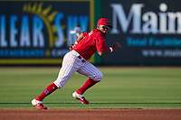 Clearwater Threshers shortstop Luis García (5) makes a diving attempt on a base hit up the middle during a game against the Dunedin Blue Jays on May 20, 2021 at BayCare Ballpark in Clearwater, Florida.  (Mike Janes/Four Seam Images)