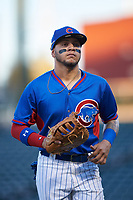 AZL Cubs 2 first baseman Abraham Rodriguez (12) jogs off the field between innings of an Arizona League game against the AZL Dbacks on June 25, 2019 at Sloan Park in Mesa, Arizona. AZL Cubs 2 defeated the AZL Dbacks 4-0. (Zachary Lucy/Four Seam Images)