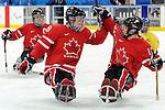 Billy Bridges and Adam Dixon, Vancouver 2010 - Para Ice Hockey // Para-hockey sure glace.<br /> Team Canada plays against Sweden in Para Ice Hockey action // Équipe Canada joue contre la Suède dans un match de para-hockey sur glace. 14/03/2010.
