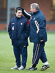 Ally McCoist with a worried looking Gary Sherriff the Rangers strength and conditioning coach