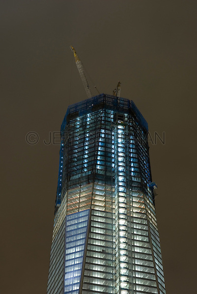 AVAILABLE FROM WWW.PLAINPICTURE.COM FOR LICENSING.  Please go to www.plainpicture.com and search for image # p5690262.<br /> <br /> Construction at Ground Zero in September 2011 - The new 1 World Trade Center under construction viewed at night, Lower Manhattan, New York City, New York State, USA