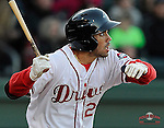 Infielder/third baseman Carlos Asuaje (20) of the Greenville Drive in a game against the Charleston RiverDogs on Wednesday, April 16, 2014, at Fluor Field at the West End in Greenville, South Carolina. (Tom Priddy/Four Seam Images)