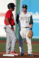 Fort Wayne TinCaps Cory Spangenberg #34 talks with Jonathan Rodriguez during a game against the Quad Cities River Bandits at Parview Field on July 25, 2011 in Fort Wayne, Indiana.  Quad Cities defeated Fort Wayne 11-10.  (Mike Janes/Four Seam Images)