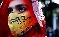 """BOGOTA, COLOMBIA - JULY 03: A member of the LGBTI+ community wearing a protective face mask with the words """"who given the order"""" during a protest against the recent  murders of several members of their community, in Bogota, Colombia, Friday, July 3, 2020. The LGTBI+ community protest against the murder of six trans women this month shouting """"Trans live matter, black trans life matter"""", more than 1300 LGBTI+ people was killed in the last five years in Latin America. (Photo by Leonardo Munoz/VIEWpress via Getty Images)"""