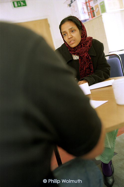A Bangladeshi woman at one of the regular housing advice surgeries held at the Linc Centre, on Poplar HARCA's Lincoln Estate, which was transferred from Tower Hamlets Council control after a ballot of residents.
