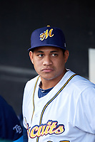 Montgomery Biscuits starting pitcher Yonny Chirinos (25) in the dugout before a game against the Mississippi Braves on April 24, 2017 at Montgomery Riverwalk Stadium in Montgomery, Alabama.  Montgomery defeated Mississippi 3-2.  (Mike Janes/Four Seam Images)