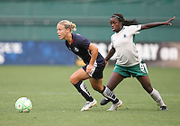 Lori Lindsey #6 of the Washington Freedom pulls away from Eniola Aluko #9 of St. Louis Athletica during a WPS match at RFK Stadium on July 18 2009, in Washington D.C. Freedom won the match 1-0.