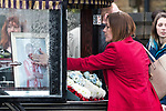 © Joel Goodman - 07973 332324 . 20/12/2017. Manchester, UK. A mourner touches her hand to Sam's photograph in the hearse , outside the church after the service . The funeral of 14-year-old Sam Berkley at Christ Church in Denton , East Manchester . Mourners wear red and white , the colours of Hattersley FC , for whom Berkley played . Amongst their number are pupils and friends from Audenshaw School . Berkley died after being hit by a grey BMW near junction 3 of the M67 in Hyde , East Manchester , on 1st December 2017 . Photo credit : Joel Goodman