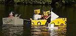 COLEBROOK, CT--- -090515JS10- Contestants make their way through the course during the annual Colebrook Fair's cardboard boat regatta Saturday at the Colebrook Town Pond. <br />  Jim Shannon Republican-American