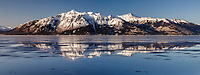 Spring Landscape of sea ice flowing and stationary in Turnagain Arm with the Kenai Mountains in the background.  South of Anchorage. <br /> <br /> <br /> Photo by Jeff Schultz/  (C) 2020  ALL RIGHTS RESERVED