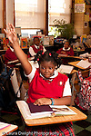 K-8 Parochial School Bronx New York Grade 5 female student raising hand vertical