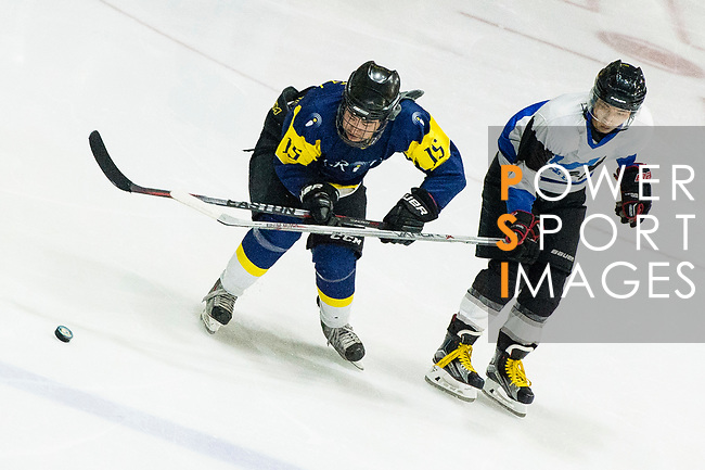 Verity Skater #15 Warren Ang (left) fights for the puck during the match Gaggia Empire vs Verity, a match part of the Principal Standard League on 07 March 2017 in Mega Ice, Hong Kong, China. Photo by Marcio Rodrigo Machado / Power Sport Images