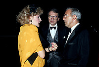 FILE PHOTO -  Louise Deschatelets (L) with her husband Guy Fournier (M) and CFCF owner Jean pouliot, circa 1986