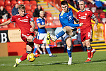Aberdeen v St Johnstone…18.09.21  Pittodrie    SPFL<br />Glenn Middleton's shot is pushed wide by Joe Lewis<br />Picture by Graeme Hart.<br />Copyright Perthshire Picture Agency<br />Tel: 01738 623350  Mobile: 07990 594431
