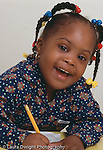 Down syndrome  toddler girl  2 years old, portrait, closeup, holding pencil