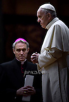 Pope Francis Monsignor Georg Gänswein attends a vigil prayer on the eve of the XIV General Assembly of the Synod of Bishops at St Peter's basilica on October 3, 2015 at the Vatican.
