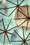 Blue and orange paper umbrellas with vintage treatment