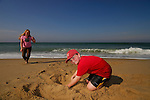 Two young children playing in the sand on Cape Cod, MA