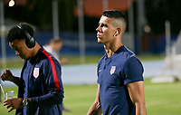 GEORGETOWN, GRAND CAYMAN, CAYMAN ISLANDS - NOVEMBER 19: Alfredo Morales #15 of the United States walks to the field during a game between Cuba and USMNT at Truman Bodden Sports Complex on November 19, 2019 in Georgetown, Grand Cayman.