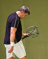 March 7, 2015, Netherlands, Hilversum, Tulip Tennis Center, NOVK, Ton van Rijthoven (NED) breaks his racket<br /> Photo: Tennisimages/Henk Koster