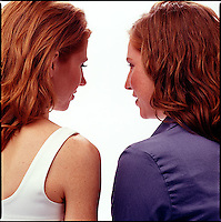 Rear view of two red haired women<br />
