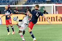 FOXBOROUGH, MA - OCTOBER 7: Ayo Akinola #20 of Toronto FC and Henry Kessler #4 of New England Revolution battle for a passed ball during a game between Toronto FC and New England Revolution at Gillette Stadium on October 7, 2020 in Foxborough, Massachusetts.