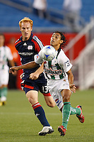 Santos Laguna midfielder Fernando Arce (5) plays the ball in front of New England Revolution midfielder Jeff Larentowicz (13)during first half action between the New England Revolution and Santos Laguna in a Group B match of the 2008 North American SuperLiga at Gillette Stadium in Foxborough, Massachusetts, on July 13, 2008.