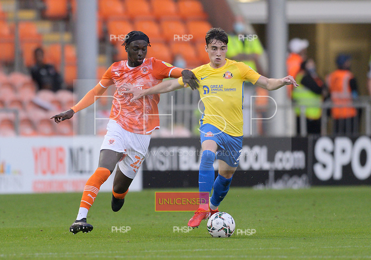 24/08/2021 Carabao Cup 2nd Round Blackpool v Sunderland <br /> <br /> Jordan Willis tussles with Cameron Antwi