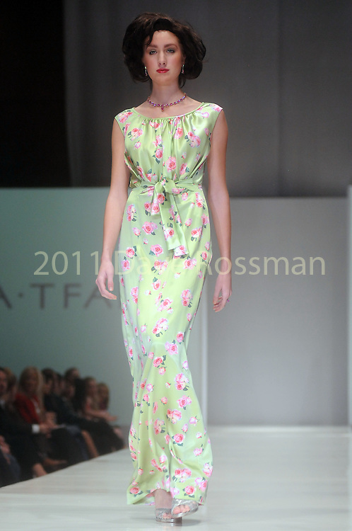 A model walks the runway wearing Barbara Tfank at the first night of Fashion Houston at the Wortham Theater Monday Oct. 10,2011.(Dave Rossman/For the Chronicle)