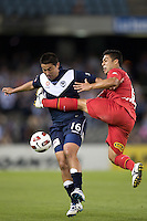 MELBOURNE, AUSTRALIA - OCTOBER 30: Carlos Hernandez of the Victory is fouled by Cassio of United during the round 12 A-League match between the Melbourne Victory and Adelaide United at Etihad Stadium on October 30, 2010 in Melbourne, Australia.  (Photo by Sydney Low / Asterisk Images)