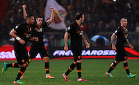 Calcio, semifinale di andata di Coppa Italia: Roma vs Napoli. Roma, stadio Olimpico, 5 febbraio 2014.<br /> AS Roma midfielder Kevin Strootman, of the Netherlands, second from left, celebrates with teammates Leandro Castan, of Brazil, left, Vasilis Torosidis, of Greece, second from  right, and Radja Nainggolan, of Belgium, after scoring during the Italian Cup first leg semifinal football match between AS Roma and Napoli at Rome's Olympic stadium, 5 February 2014.<br /> UPDATE IMAGES PRESS/Isabella Bonotto