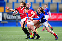 Alisha Butchers of Wales is tackled by Pauline Bourdon of France during the Women's Six Nations Championship Round 3 match between Wales and France at the Cardiff Arms Park in Cardiff, Wales, UK. Sunday 23 February 2020