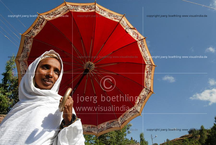 ETHIOPIA Lalibela, orthodox christian woman with red umbrella / AETHIOPIEN Lalibela, Frau mit Schirm