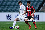 Auckland City Midfielder Fabrizio Tavano (l) is chased by FC Seoul Midfielder Ju Se Jong (r) during the 2017 Lunar New Year Cup match between Auckland City FC (NZL) vs FC Seoul (KOR) on January 28, 2017 in Hong Kong, Hong Kong. Photo by Marcio Rodrigo Machado/Power Sport Images