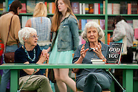 Tuesday 31 May 2016. Hay on Wye, UK<br /> Pictured: Women chatting in the book shop at the festival<br /> Re: The 2016 Hay festival take place at Hay on Wye, Powys, Wales