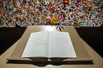 A condolence register with the signatures of Dutch King Willem-Alexander and Queen Maxima ( right page) lies in front of a hedge of compassion prior to a commemoration ceremony in Nieuwegein, near the central city of Utrecht, the Netherlands, Thursday, July 16, 2015.REUTERS/Michael Kooren/Pool