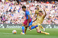 26th September 2021; Nou Camp, Barcelona, Spain: La Liga football, FC Barcelona versus Levante:  Coutinho is challenged by Postigo