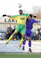 Thurrock vs Grays Athletic - 26/12/04 - Nationwide Conference South - Thurrock's Tresor Kandol flies high to beat Grays' Jamie Stuart in the air - (Gavin Ellis)
