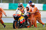 KUALA LUMPUR, MALAYSIA - OCTOBER 25: Repsol Honda Team rider Andrea Dovizioso of Italy is helped by marshalls after slides off the track during the Malaysian MotoGP, which is round 16 of the MotoGP World Championship at the Sepang Circuit on October 25, 2009 in Kuala Lumpur, Malaysia. Photo by Victor Fraile / The Power of Sport Images